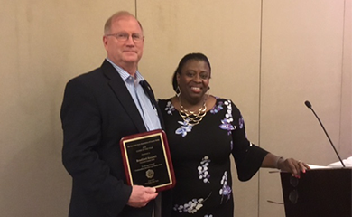 County Clerk Brad Kendall receives award from