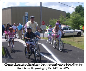County Executive and bicyclists at DRT Phase II Opening