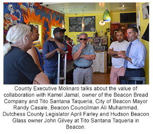 County Executive Molinaro and Mayor Randy Casale chat with Main Street Beauty Club owner Michael Bell with Dutchess County Legislator April Farley and Beacon Councilman Ali Muhammad.