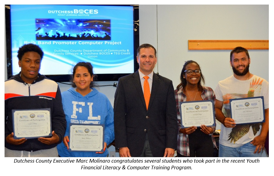Dutchess County Executive Marc Molinaro congratulates several students who took part in the recent Youth Financial Literacy & Computer Training Program