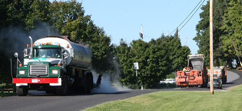 Photo: Truck and equipment applying paver-placed surface treatment