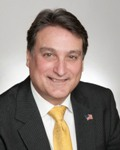 JAMES J. MICCIO