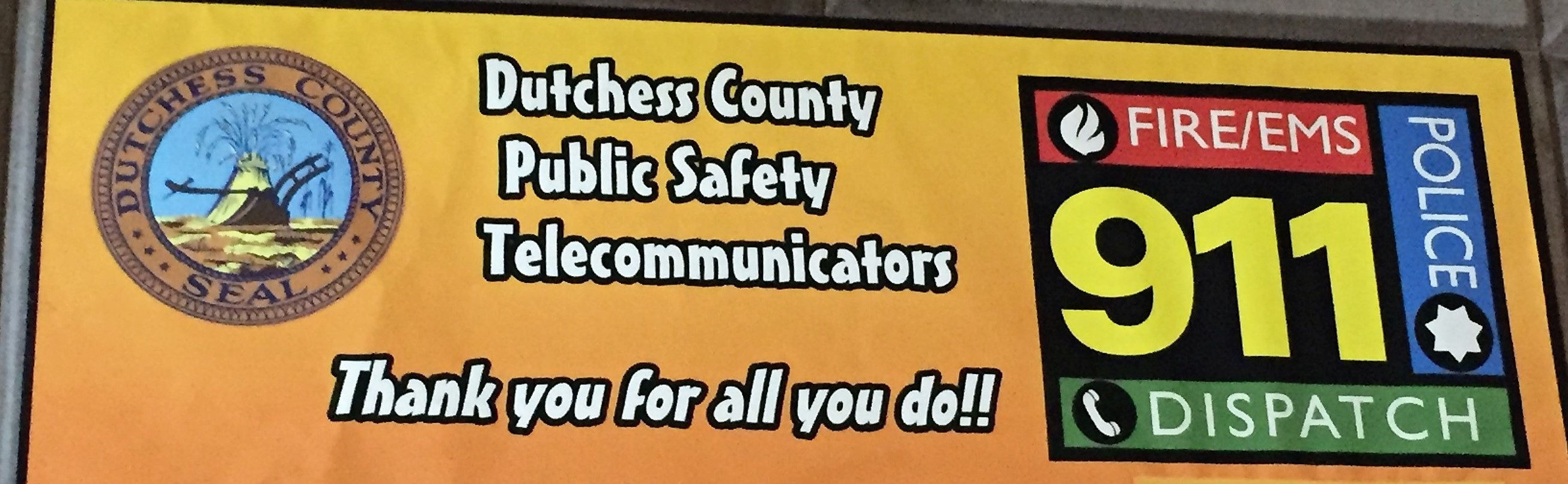 """Photo of a banner: """"Dutchess County Public Safety Telecommunicators - Thank you for all you do!  Fire, EMS, Police, Dispatch"""