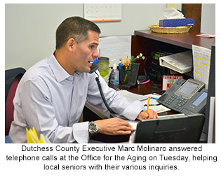 Dutchess County Executive Marc Molinaro answered telephone calls at the Office for the Aging on Tuesday.