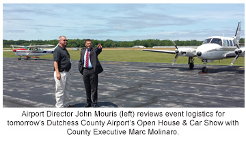 Airport Director John Mouris (left) reviews event logistics for tomorrow's Dutchess County Airport's Open House & Car Show with County Executive Marc Molinaro.