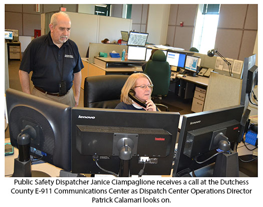 Public Safety Dispatcher Janice Clampaglione receives a call at the Dutchess County E-911 Communications Center
