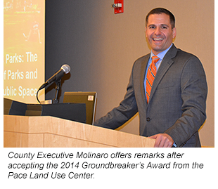 Photo of County Executive Molinaro - County Executive Molinaro offers remarks after accepting the 2014 Groundbreaker's Award from the Pace Land Use Center.