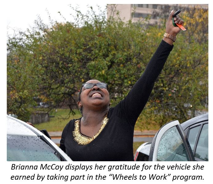 "Brianna McCoy displays her gratitude for the vehicle she earned by taking part in the ""Wheels to Work"" program"
