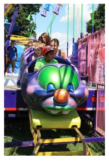 Photo: Kids riding a roller coaster at the Dutchess County Fair