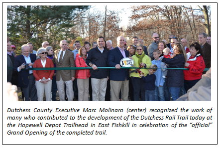 """Dutchess County Executive Marc Molinaro (center) recognized the work of many who contributed to the development of the Dutchess Rail Trail today at the Hopewell Depot Trailhead in East Fishkill in celebration of the """"official"""" Grand Opening of the completed trail."""