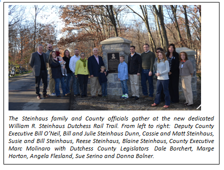 The Steinhaus family and County officials gather at the new dedicated William R. Steinhaus Dutchess Rail Trail. From left to right:  Deputy County Executive Bill O'Neil, Bill and Julie Steinhaus Dunn, Cassie and Matt Steinhaus, Susie and Bill Steinhaus, Reese Steinhaus, Blaine Steinhaus, County Executive Marc Molinaro with Dutchess County Legislators  Dale Borchert, Marge Horton, Angela Flesland, Sue Serino and Donna Bolner.