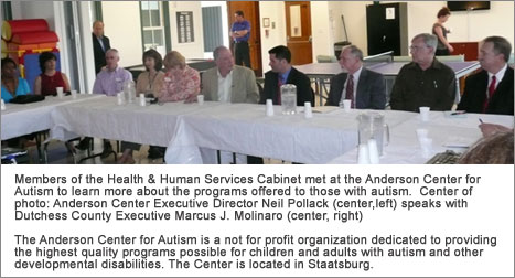 County Executive Molinaro sitting with County employees and representatives from Anderson Center for Autism
