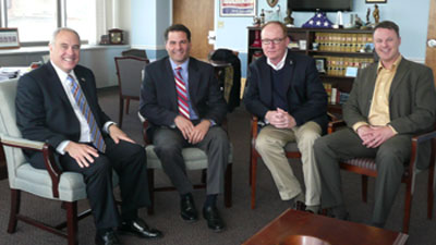County Executive Molinaro sitting with NYS Comptroller DiNapoli, Chairman Rolison and County Comptroller Coughlan