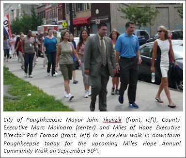 County Executive Molinaro walking on Main Street with Miles of Hope representatives