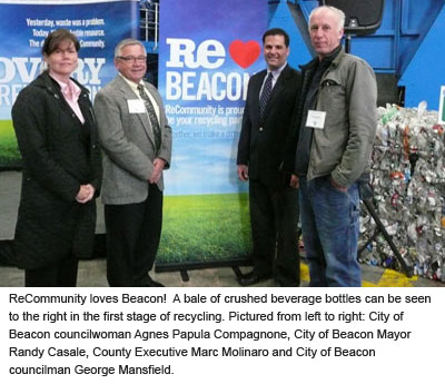 County Executive Molinaro standing next to crushed bottles with Mayor Casale and members from Beacon Council