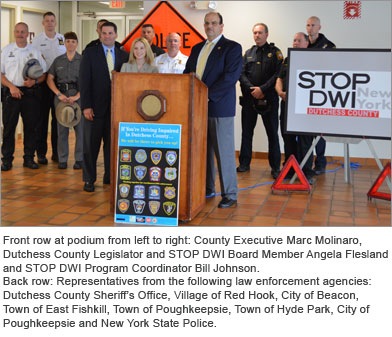 County Executive Molinaro at podium with representatives from local law enforcement agencies and Stop-DWI board members