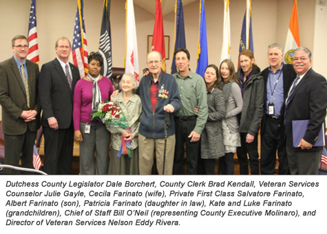 County officials with medal recipients