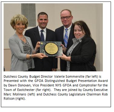 County officials holding GFOA award