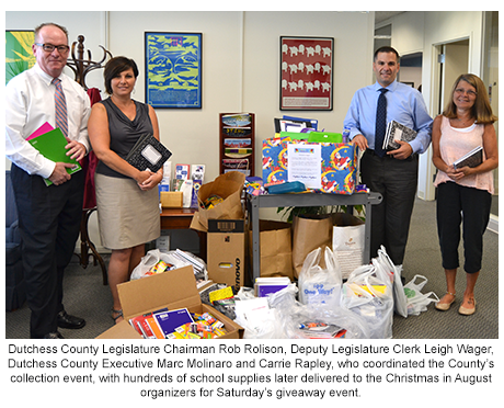 County officials with school supplies