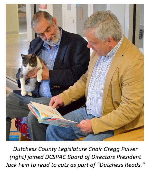 Legislative Chairman Gregg PUlver and DCSPCA Board of Directors President Jack Fein reading to cat