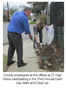County employees cleaning up debris in front of 27 High Street