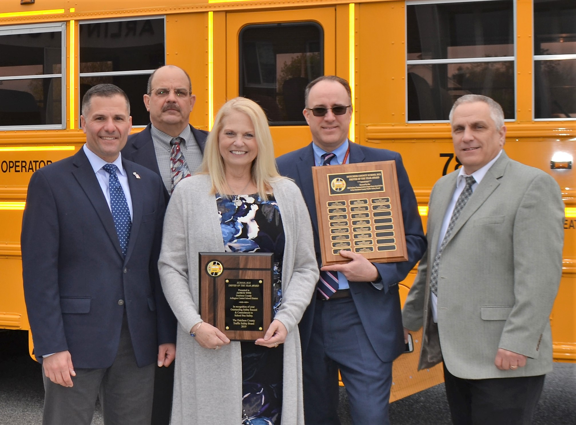 Dutchess County Executive Marcus J. Molinaro and Dutchess County Traffic Safety Board Administrator William C. Johnson presented Janice Tito with the 18th annual Dutchess County School Bus Driver of the Year Award. From left, County Executive Molinaro, Mr. Johnson, Ms. Tito, Arlington Central School District Superintendent Brendan J. Lyons, and Mid-Hudson Transportation Supervisor's Association President Ron Mackey.