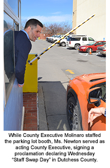 County Executive Molinaro staffing the parking lot booth