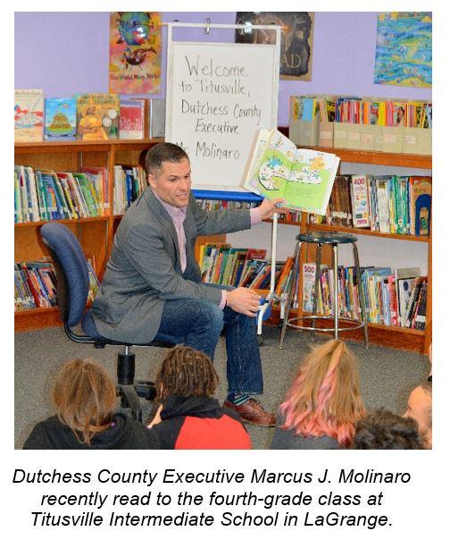 County Executive Marc Molinaro reading to children