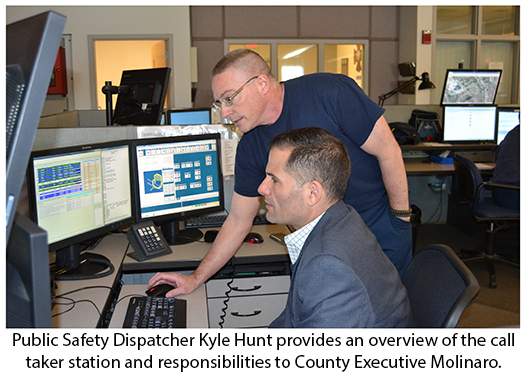 County Executive Molinaro with public safety dispatcher at call taker station