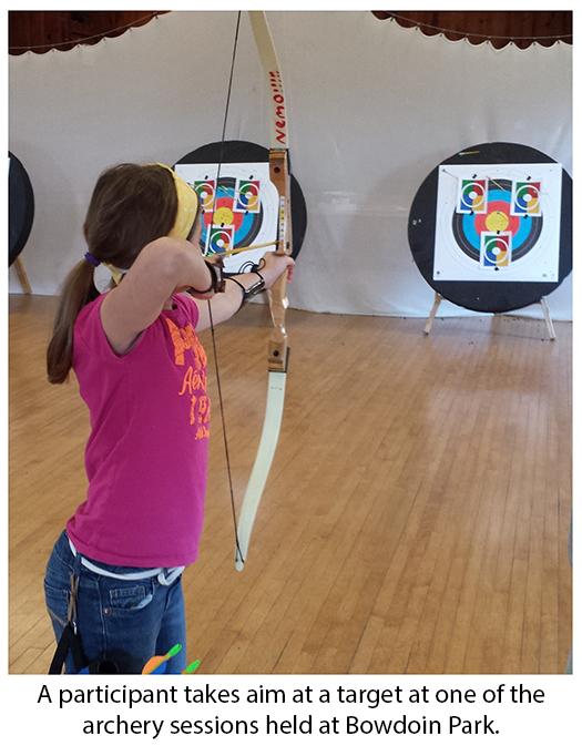 Archery session participant taking aim at target