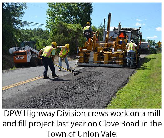 DPW employees repaving Clove Road