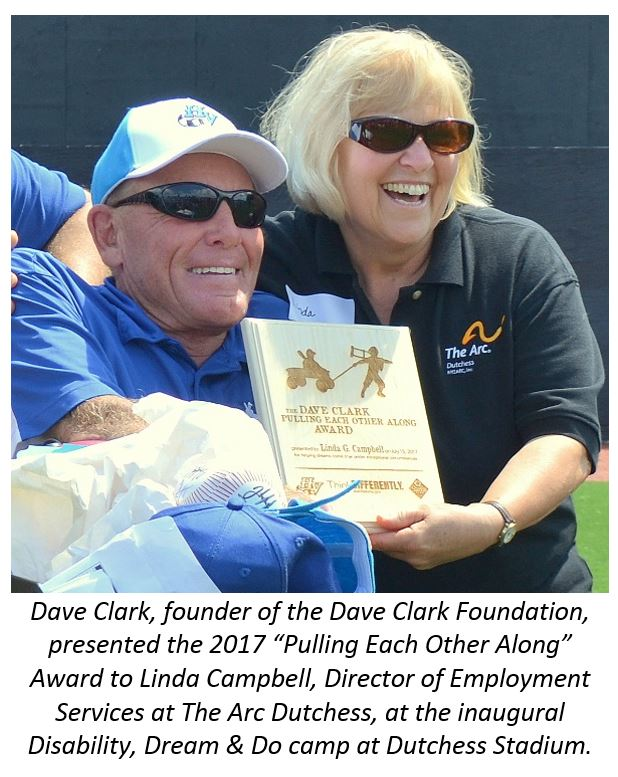 Dave Clark founder of the Dave Clark Foundation, presented the 2017 Pulling Each Other Along Award to Linda Campbell, Director of Employment Services t the Arc Dutchess, at the inagural Disability, Dream and Do camp at Dutchess Stadium