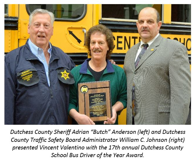 Sheriff Anderson, School Bus Driver of the Year Award winner Vincent Valention, Traffic Safety Board Administrator William Johnson